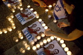 Israelis mourns and light candles in Rabin Square in Tel Aviv on June 30 2014 after the announce that the bodies of the three missing Israeli...