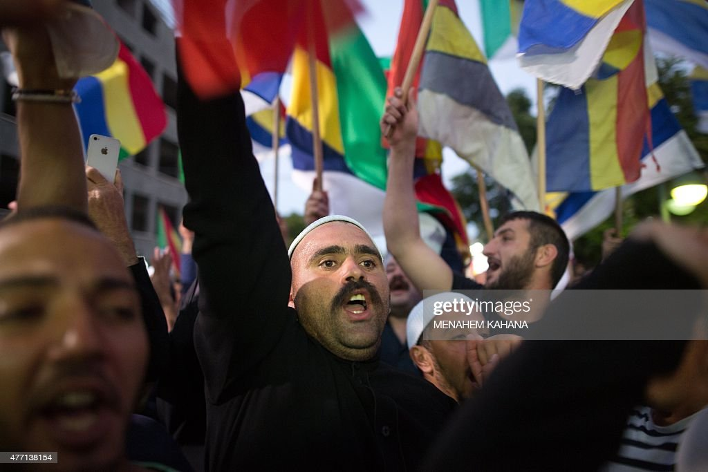 Israelis of the Druze minority wave their flag during a demonstration of some two thousand people in the northern Israeli Druze town of Daliyat...