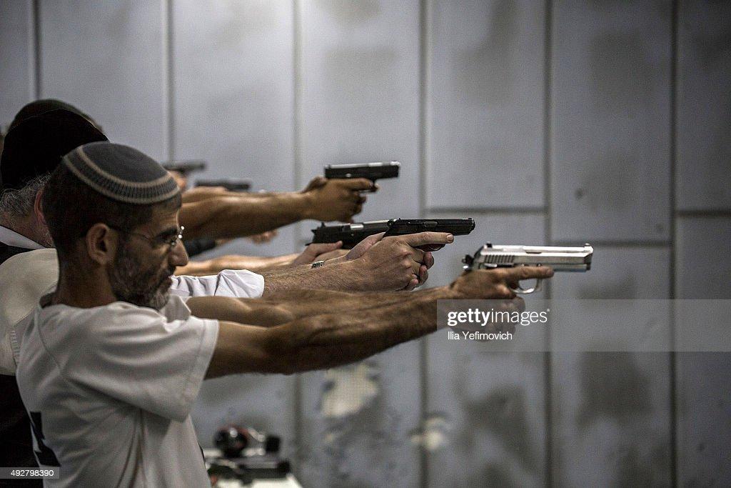Israelis practise shooting in the gun shooting range on October 15 2015 in Jerusalem Israel The Israeli Government issued police reinforcements...