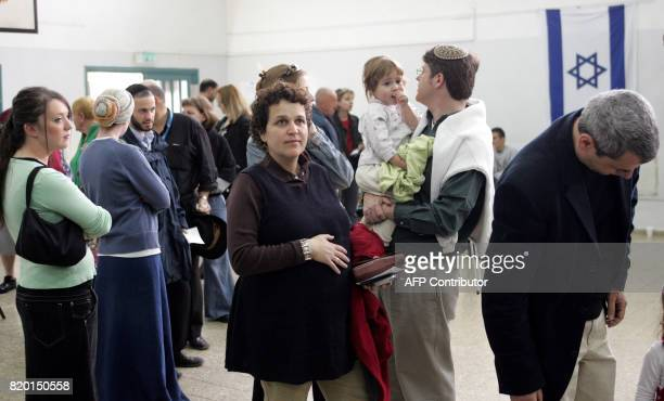 Israelis queue up to cast their vote in the general elections 28 March 2006 at a polling station in Jerusalem Israel headed to the polls today in a...
