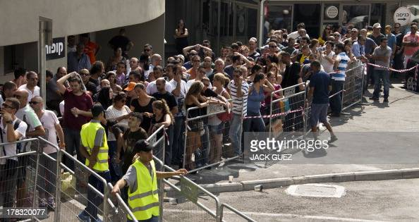 Israelis queue up to collect gas mask kits at a distribution center in the Mediterranean coastal city of Haifa northern Israel on August 29 2013...