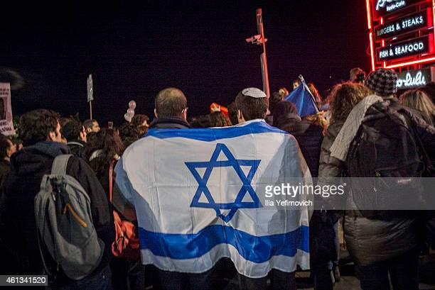 Israelis rally outside the French embassy on January 11 2015 in TelAviv Israel Four bodies of victims of the terrorist attack in France are scheduled...