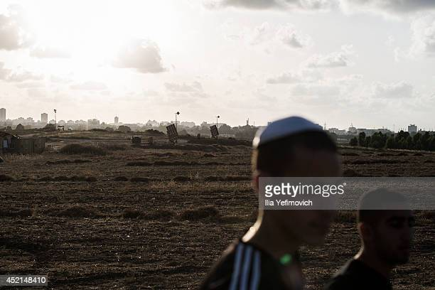 Israelis seen by a Iron Dome unit missile system on July 14 2014 at the city of Ashdod Israel's operation 'Protective Edge' has entered a seventh day...