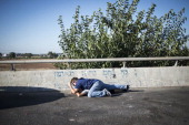 17 Israelis seen taking cover on a highway as a siren sounds on July 17 2014 in Telaviv Israel As the Israeli operation 'Protective Edge' enters it's...