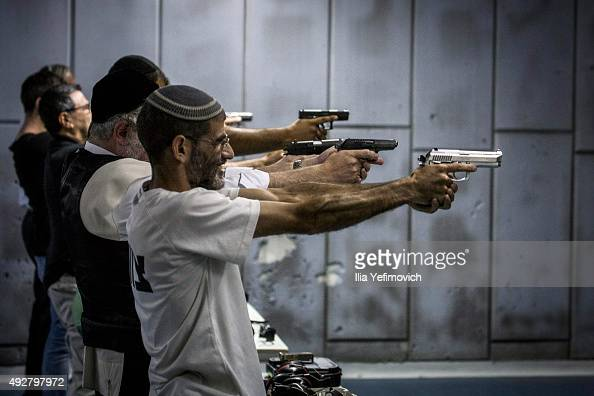 Israelis shoot in the gun shooting range on October 15 2015 in Jerusalem Israel The Israeli Government issued police reinforcements across Israel...