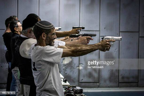 Israelis shoot in the gun shooting range on October 15 2015 in Jerusalem Israel The Israeli Government issued police reinforcements across Israel...