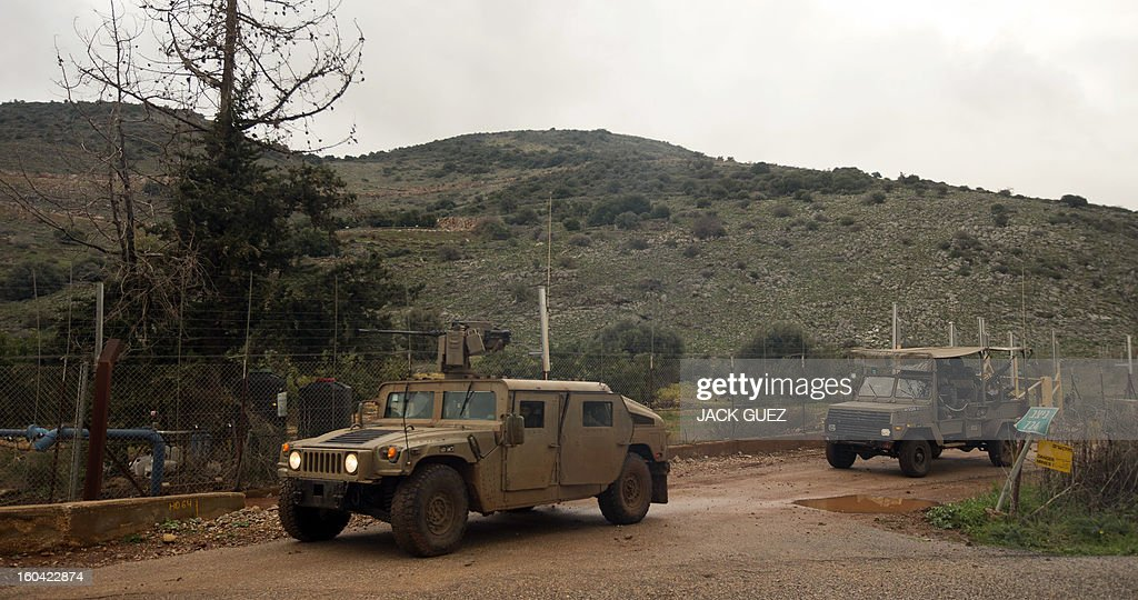 Israelis soldiers patrol along the Israel-Lebanon border on January 31, 2103 a day after an overnight Israeli strike in the Lebanon-Syria border area. Iran's deputy foreign minister said that the alleged Israeli air strike on a Syrian military research facility a day earlier will have 'grave consequences.'
