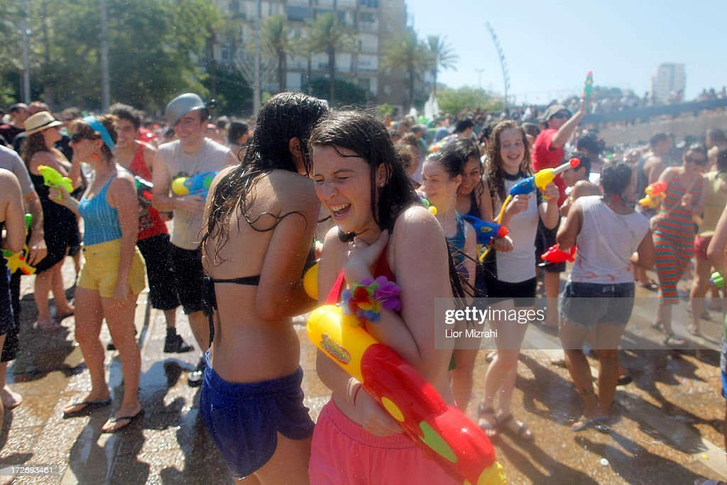 Israelis spray each other with water July 5, 2013 in Tel Aviv, Israel. Hundreds of Israelis and tourists took part in the 9th annual water fight at Rabin Square.