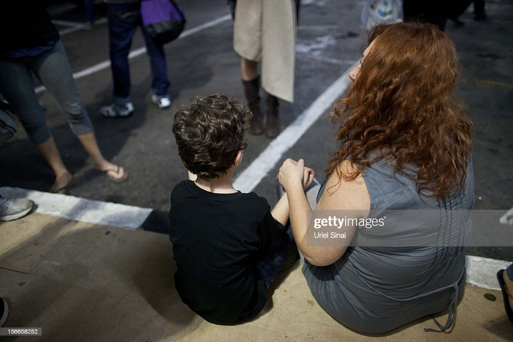 Israelis take cover at a a shopping centre parking garage during a rocket attack on November 18, 2012 in Tel Aviv, Israel. At least 53 Palestinians and three Israeli's have died since the conflict began five days ago.