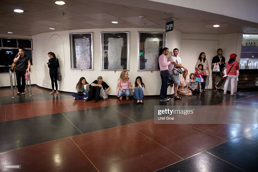 Israelis take cover at a shopping centre during a rocket attack on November 18, 2012 in Tel Aviv, Israel. At least 53 Palestinians and three Israeli's have died since the conflict began five days ago.