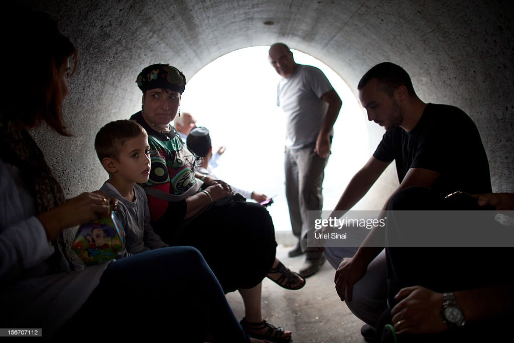 Israelis take cover in a large concrete pipe used as a bomb shelter during a rocket attack from the Gaza Strip on November 19, 2012 in Nitzan, Israel. According to reports November 19, 2012, at least 90 Palestinians have been killed and more than 700 wounded during the Israeli offensive in the Gaza Strip.