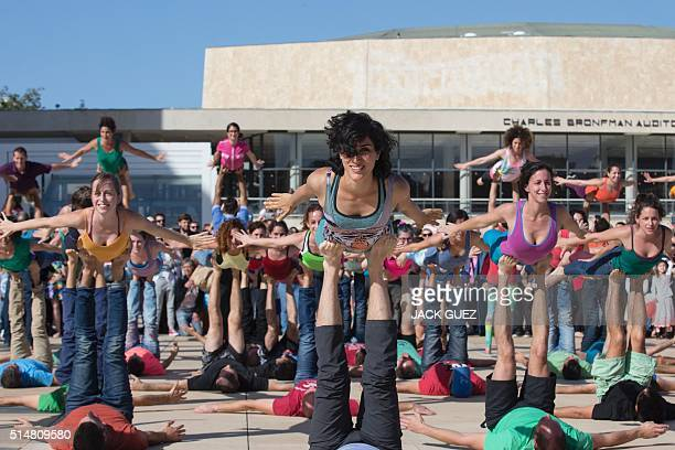 Israelis take part in a large acroyoga flashmob on March 11 2016 on Habima Square in the coastal city of Tel Aviv Some 150 people took part in the...