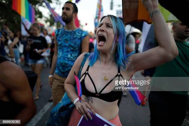 Israelis take part in the first annual Gay Pride parade in the southern Israeli city of Beersheba on June 22 2017 Hundreds of Israelis march in...