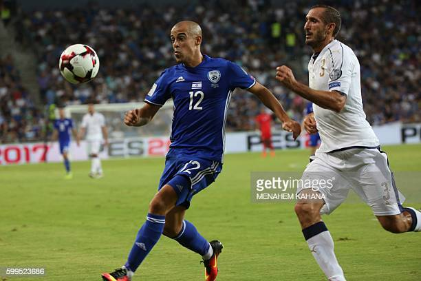 Israeli's Tal ben Haim vies with Italy's Giorgio Chellini during the World Cup 2018 qualifier football match Israel vs Italy at Sammy Ofer Stadium in...