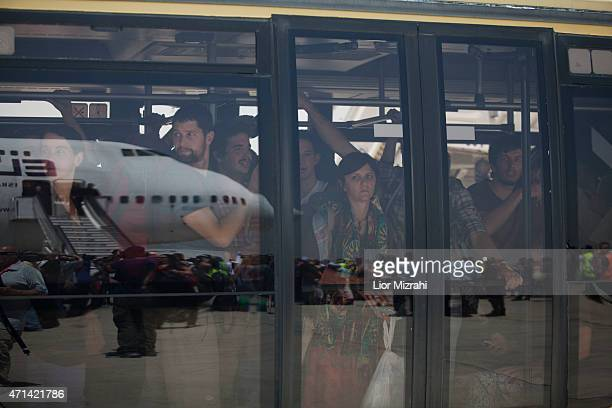 Israelis travelers from Nepal are seen inside a bus after they disembark from an Israeli rescue plane after it landed in Ben Gurion Airport on April...