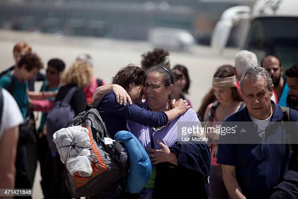 Israelis travelers from Nepal hugging each other and cry after disembarking from an Israeli rescue plane after it landed at Ben Gurion Airport on...