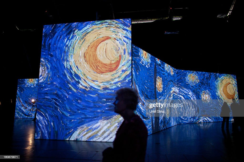 Israelis visit a multimedia art exhibition entitled 'Van Gogh Alive' featuring the work of the painter Vincent van Gogh, on February 7, 2013 in Tel Aviv, Israel. The exhibition explores the work of the artist through more than 3,000 images, across giant screens, walls and floors allowing the viewer to see his paintings in microscopic fine detail.