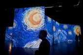 Israelis visit a multimedia art exhibition entitled 'Van Gogh Alive' featuring the work of the painter Vincent van Gogh on February 7 2013 in Tel...