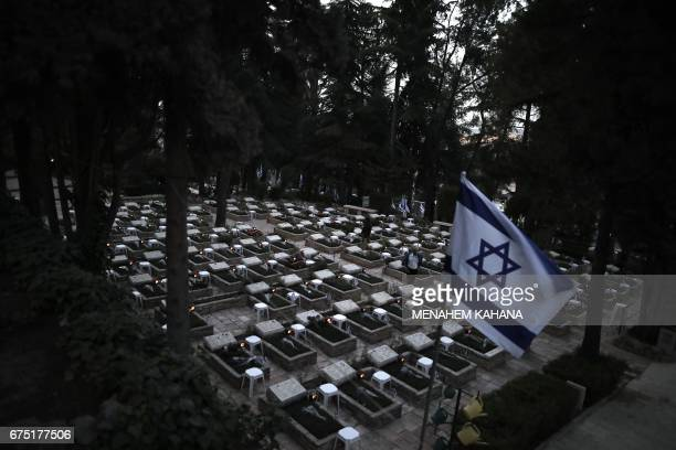 Israelis visit the Mount Herzel military cemetery in Jerusalem on April 30 at the start of Remembrance Day commemorating fallen Israeli soldiers...