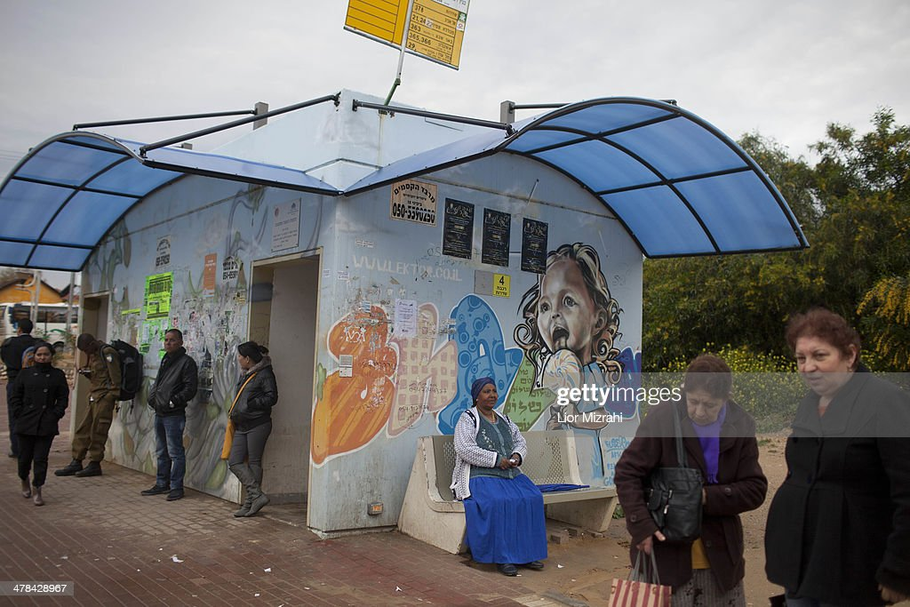 Israelis wait at a bus station next to a bomb shelter on March 13 2014 in Sderot Israel Israeli air forces attacked seven sites in the Gaza Strip...