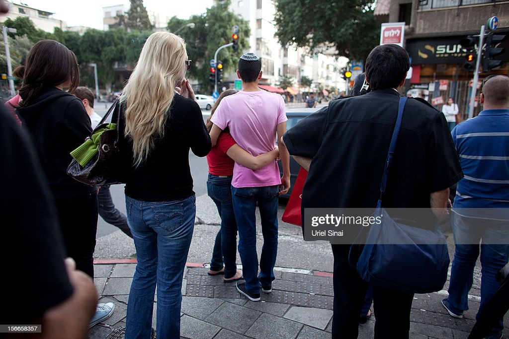 Israelis wait at a stoplight on November 18, 2012 in Tel Aviv, Israel. At least 53 Palestinians and three Israeli's have died since the conflict began five days ago.