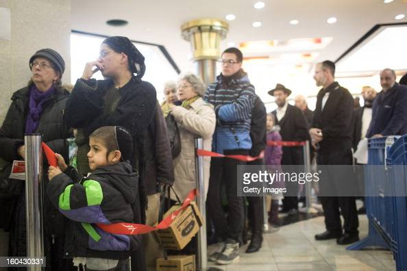 Israelis wait in a line to collect gas mask kits from a distribution station in a mall January 31 in Pisgat Ze'ev East Jerusalem Israel Israel...
