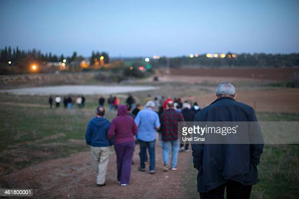 Israelis walk away after visiting the grave the day Gilad Sharon the son of former PM Ariel Sharon visited the grave of his mother Lili were his...