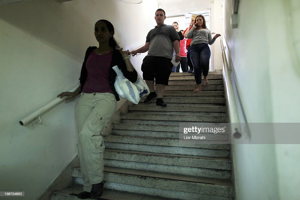 Israelis walk down to a shelter while air raid sirens sound November 19, 2012 in Ashdod, Israel. According to reports November 19, 2012, at least 90 Palestinians have been killed and more than 700 wounded during the Israeli offensive in the Gaza Strip.