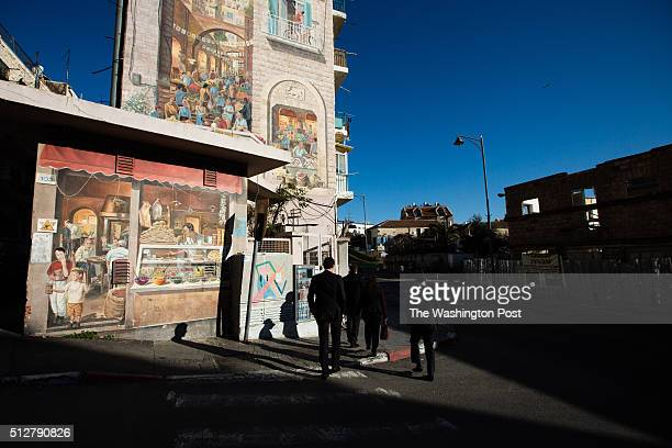 Israelis walk past a mural at the Mahane Yehuda Market often called 'The Shuk' on February 24 in Jerusalem Israel For a story by William Booth and...