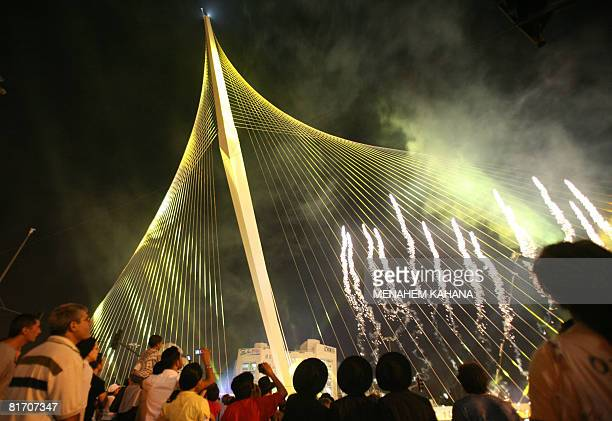 Israelis watch fireworkds during the inauguration ceremony of the 'Chords Bridge' designed by Spanish architect Santiago Calatrava at the main...