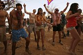 Israelis wearing costumes dance in a desert rave during the feast of Purim on March 7 2015 in the Negev Desert in southern Israel The carnivallike...