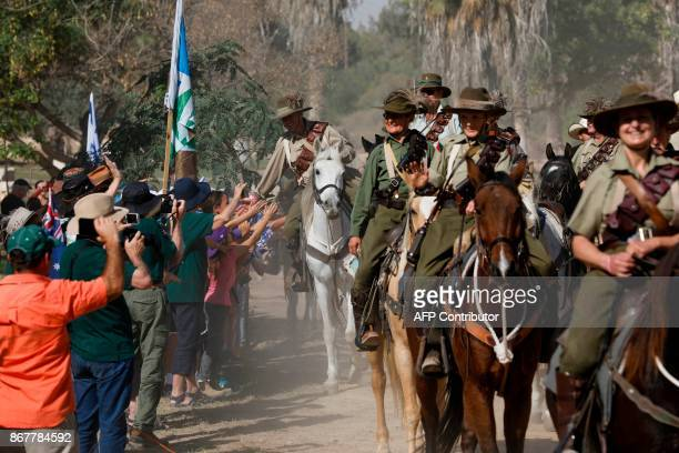 Israelis welcome members of the Australian Light Horse association as they ride their horses on October 29 2017 near BeerSheva on the northern...