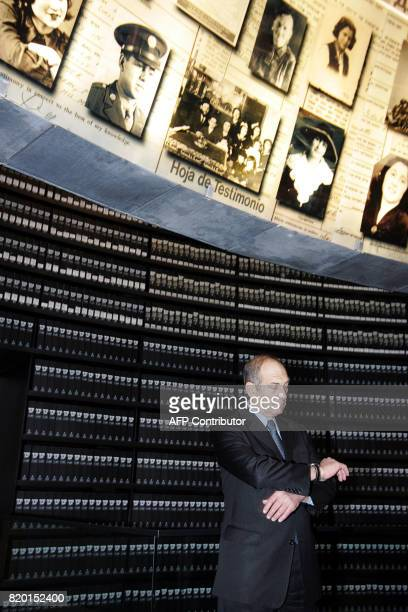 Israel's Acting Prime Minister Ehud Olmert checks the time as he and his cabinet visit the Hall of Names during a special Cabinet meeting in honor...