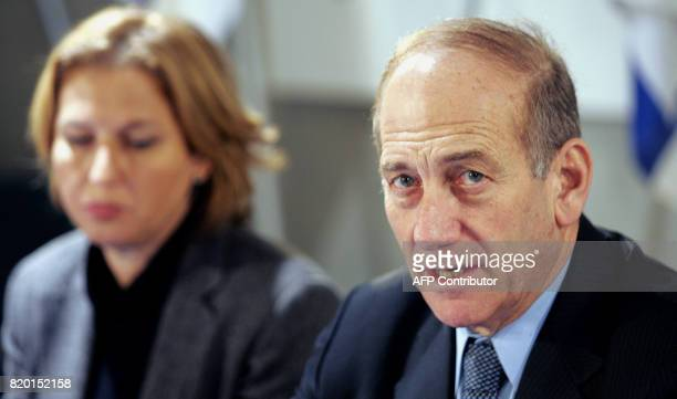 Israel's Acting Prime Minister Ehud Olmert sits with his Foreign Minister Tzipi Livni at a special Cabinet meeting in honor International Holocaust...