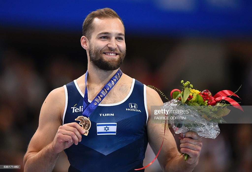 Israels Alexander Shatilov (3rd) celebrates on the podium after the Mens Floor competition of the European Artistic Gymnastics Championships 2016 in Bern, Switzerland on May 29, 2016. / AFP / FABRICE