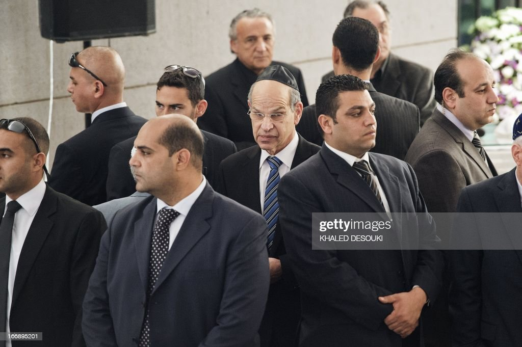 Israel's Ambassador to Egypt Yaakov Amitai (C) is surrounded by bodyguards as he arrives to deliver a speech during the funeral of the president of the Egyptian Jewish Community Carmen Weinstein at the Adly Synagogue on April 18, 2013 in Cairo, Egypt. Carmen Weinstein, the leader of Egypt's tiny remaining Jewish community, died on Saturday at the age of 84, a friend and lawyer said. Weinstein, who fought for the preservation of Jewish synagogues and heritage sites in Egypt, died of natural causes, said Magda Haroun, one of the few Jews left in the Arab country. AFP PHOTO/KHALED DESOUKI