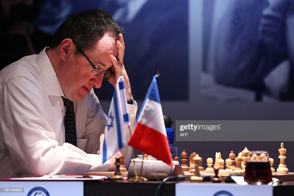 Israel's Boris Guelfand plays during a round 2 game of the Alekhine Memorial chess tournament on April 22, 2013 in Paris. The tournament is a 10-player single round competition, with the first half held in Paris from April 20 to 25, and the second half in the Russian State Museum in St. Petersburg from APril 26 to May 1st.