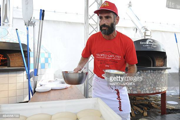Israel's competitor Isaac Aram prepares his pizza during the 2014 Pizza makers World Championships in Naples on September 3 2014 AFP PHOTO/MARIO...