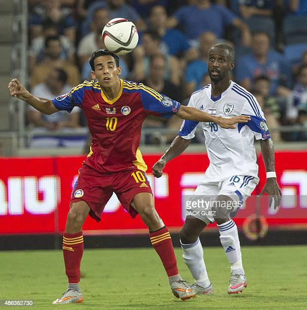 Israel's defender Eliazar Dasa vies for the ball with Andorra's midfielder Aaron Sanchez during their Euro 2016 qualifying football match at the...