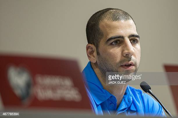 Israels defender Tal Ben Haim speaks during a press conference at the Sammy Ofer Stadium in the Israeli Mediterranean coastal city of Haifa on March...