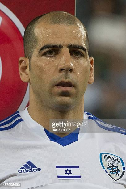 Israel's defender Tal ben Haim stands on the pitch before the Euro 2016 qualifying football match between Israel and Wales at the Sammy Ofer Stadium...