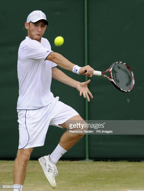 Israel's Dudi Sela in action against Serbia's Novak Djokovic during the Wimbledon Championships at the All England Lawn Tennis and Croquet Club...