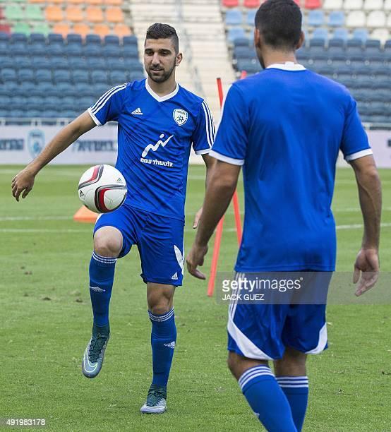 Israel's football team's forward Munas Dabbur attends a training session at the Teddy Kollek Memorial Stadium in the city of Jerusalem on October 9...