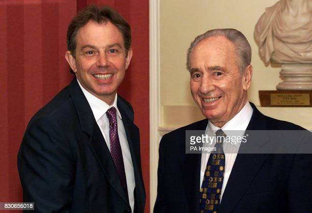 Israel's Foreign Affairs Minister Shimon Peres is greeted by British Prime Minister Tony Blair at No10 Downing Street London Speaking to reporters...