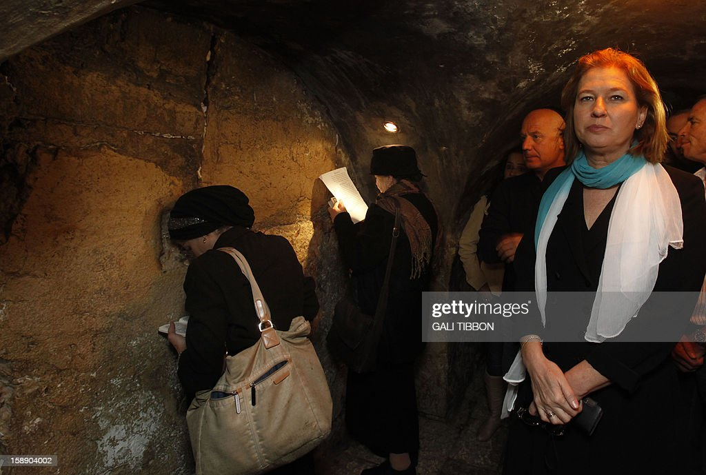 Israel's former foreign minister and chairman of a new party called The Movement, Tzipi Livni (R), visits the Western Wall tunnels in Jerusalem's Old City, during her election campaign, on January 3, 2013. Livni announced her return at the helm of The Movement party, nearly seven months after she stepped aside following a primary defeat.
