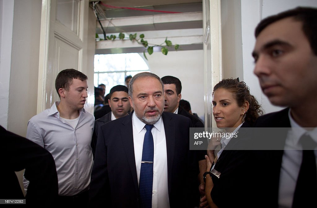 Israel's former foreign minister Avigdor Lieberman (C) arrives at the magistrate court for the continuation of his trial on April 25, 2013 in Jerusalem. Lieberman is suspected of trying to secure an ambassadorial posting for Israeli diplomat Zeev Ben Aryeh who provided him with confidential information about a police investigation into his affairs.
