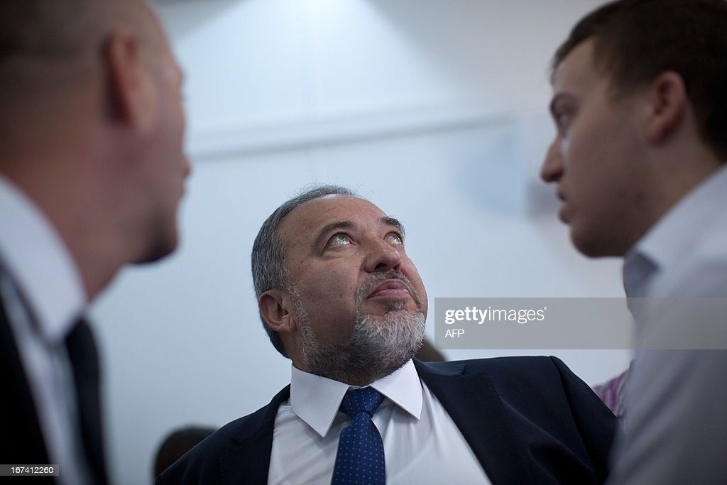 Israel's former foreign minister Avigdor Lieberman (C) arrives at the magistrate court for his trial on charges of fraud and breach of trust on April 25, 2013 in Jerusalem. Lieberman is suspected of trying to secure an ambassadorial posting for Israeli diplomat Zeev Ben Aryeh who provided him with confidential information about a police investigation into his affairs.