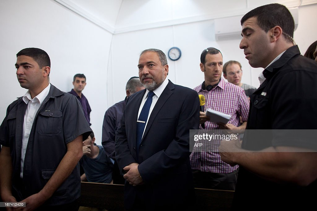 Israel's former foreign minister Avigdor Lieberman (2L) arrives at the magistrate court for his trial on charges of fraud and breach of trust on April 25, 2013 in Jerusalem. Lieberman is suspected of trying to secure an ambassadorial posting for Israeli diplomat Zeev Ben Aryeh who provided him with confidential information about a police investigation into his affairs.