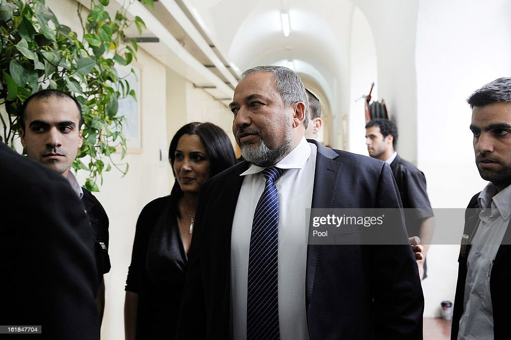 Israel's former Foreign Minister <a gi-track='captionPersonalityLinkClicked' href=/galleries/search?phrase=Avigdor+Lieberman&family=editorial&specificpeople=652650 ng-click='$event.stopPropagation()'>Avigdor Lieberman</a> (C) arrives for the opening hearing of his trial in which is he is facing charges of fraud and breach of trust, at Jerusalem Magistrates Court on February 17, 2013 in Jerusalem, Israel. Concerning incidents which took place more than a decade ago, Lieberman is accused of trying to advance the career of a former diplomat who relayed information to him about a since closed criminal investigation into his business dealings. Lieberman pleaded not guilty on all counts, expressing confidence that he will be cleared of all charges so that he may resume his role as Foreign Minister.
