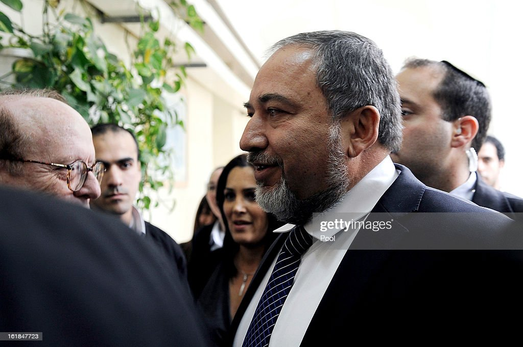 Israel's former Foreign Minister <a gi-track='captionPersonalityLinkClicked' href=/galleries/search?phrase=Avigdor+Lieberman&family=editorial&specificpeople=652650 ng-click='$event.stopPropagation()'>Avigdor Lieberman</a> arrives for the opening hearing of his trial in which is he is facing charges of fraud and breach of trust, at Jerusalem Magistrates Court on February 17, 2013 in Jerusalem, Israel. Concerning incidents which took place more than a decade ago, Lieberman is accused of trying to advance the career of a former diplomat who relayed information to him about a since closed criminal investigation into his business dealings. Lieberman pleaded not guilty on all counts, expressing confidence that he will be cleared of all charges so that he may resume his role as Foreign Minister.